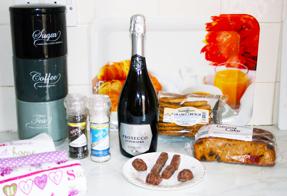 Our FREE welcome pack contains a bottle of Prosecco, tea, coffee, sugar, milk, biscuits, fruit cake and chocolates